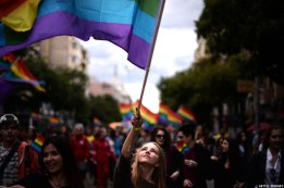 Sofia, Bulgaria: A woman waves a rainbow flag during the annual Gay Pride parade in central Sofia on September 21, 2013 as gays, lesbians and transsexuals march through the Bulgarian capital to protest against discrimination against homosexuals and call for their better integration into society.